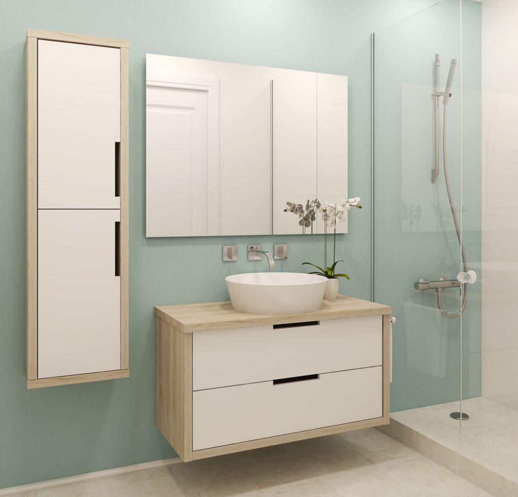 A modern interior of a white and green bathroom